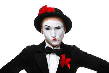 dissatisfaction: Portrait of the doubting woman as mime with dissatisfaction with a grimace on his face isolated on white background