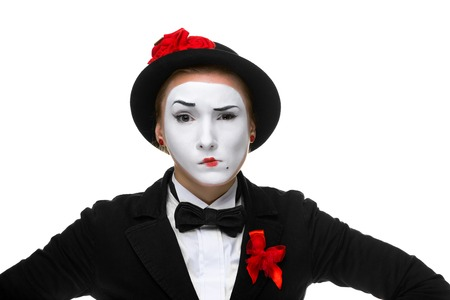 dissatisfaction: Portrait of the doubting woman as mime with dissatisfaction with a grimace on his face isolated on white background.
