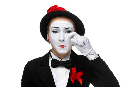 Portrait of the sad and crying woman as mime isolated on white background. photo
