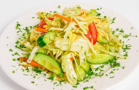 seasoned: vegetable mix with apples, celery, seasoned with lime sauce and cilantro on a white plate
