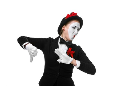 condemnation: Portrait of the condemning woman as mime with dissatisfaction with a grimace on his face isolated on white background. Concept of  of rejection and condemnation