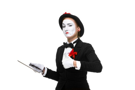 approving: approving business woman in the image mime holding tablet PC isolated on white background