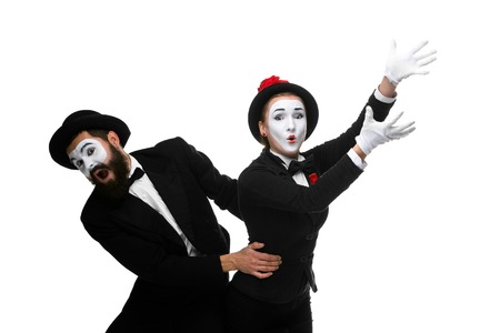 to interfere: Mime holding another one up and running, isolated on white background. Concept of career and ambition of a businessman Stock Photo