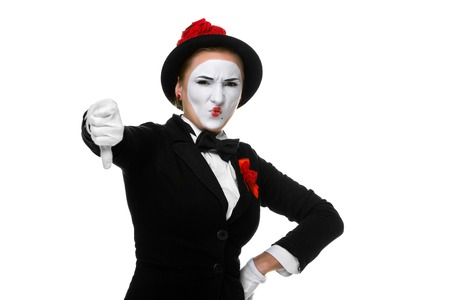 abruption: Portrait of the condemning woman as mime with dissatisfaction with a grimace on his face isolated on white background. Concept of  of rejection and condemnation