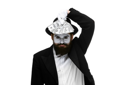 power of money: mime as businessman holding money isolated on a white background. concept  love of money and power Stock Photo