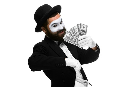 Man with a face mime screaming with delight with money isolated on a white background. concept concept- money in pocket,  money luck