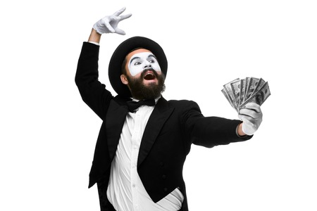 Man with a face mime dancing with money isolated on a white background. concept concept love of money, happiness from money luck Imagens
