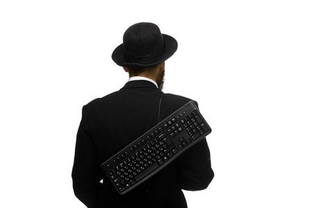 mime as a businessman holding a keyboard behind, isolated on white background. view from the back. concept of confident user photo