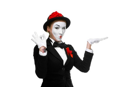 approving: Portrait of the approving woman as mime showing that everything is fine, isolated on white background.