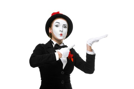 recommendations: Portrait of the surprised woman as mime isolated on white background. Concept of approval and recommendations