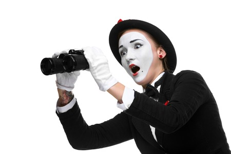 unexpected: Portrait of the surprised and joyful woman as mime with binoculars isolated on white background. Concept unexpected and joyful discovery