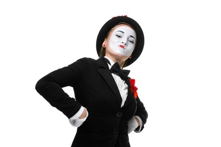 arrogant: Portrait of the proud and arrogant woman as mime in a proud pose. isolated on white background. The concept of excellence