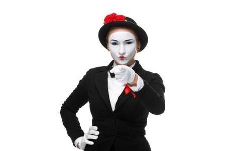 Portrait of the mime with pointing finger isolated on white background. concept of choice photo