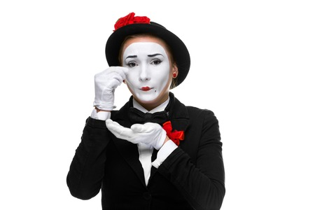 Portrait of the sad and crying woman as mime isolated on white background. Concept of resentment and bitterness photo