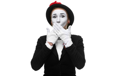 recommendations: Portrait of the frightened woman as mime isolated on white background. Concept of approval and recommendations