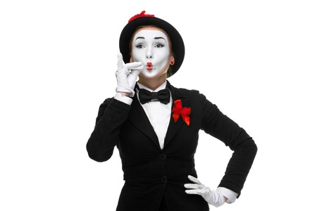 approving: Portrait of the approving woman as mime showing something very small in size, isolated on white background.