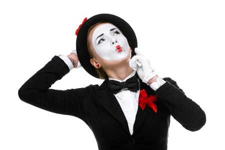 recommendations: Portrait of the surprised and joyful woman as mime isolated on white background. Concept of approval and recommendations