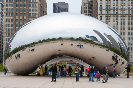 il: CHICAGO, IL - November 5: Cloud Gate and Chicago skyline on November 5, 2008 in Chicago, Illinois. Cloud Gate is the artwork of Anish Kapoor as the famous landmark of Chicago in Millennium Park.