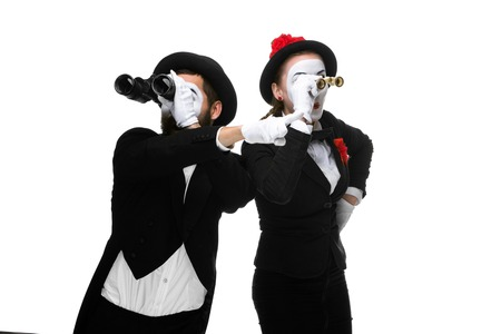 memes: Two memes as business people  looking through binoculars isolated on white background. concept of search and surprise Stock Photo
