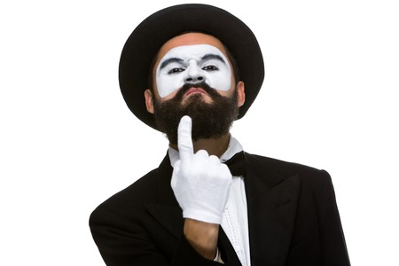 Portrait of the mime with pointing finger isolated on white background. concept of confidence photo