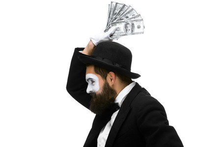 Man with a face mime dancing with money isolated on a white background. concept  love of money, happiness from money luck
