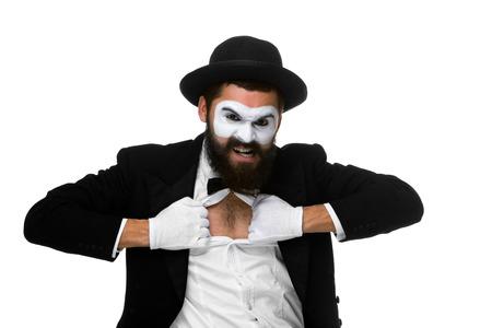 mimo: mime como un hombre de negocios que rasga su camisa fuera aislado sobre fondo blanco. Concepto determinaci�n y coraje Foto de archivo