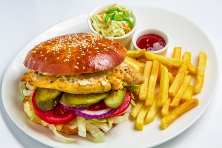hamburger with potatoes on white background photo