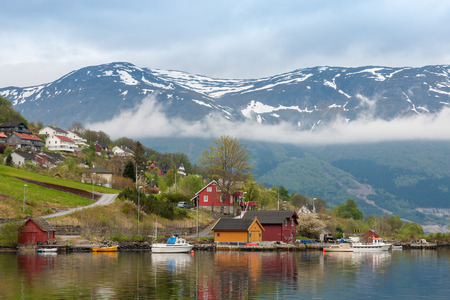 olden: Landscape with mountains in Norwegian village. spring in Norwegian fjords Stock Photo