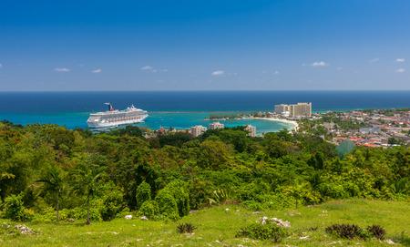 Jamaican Beach A. Caribbean white sand beach on the northern coast of Jamaica, near Dunns River Falls and the town of Ocho Rios.