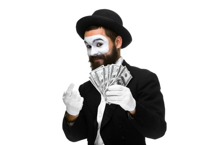 Man with a face mime luring money, isolated on a white background. concept  of promise benefits Imagens