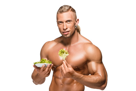 Shaped and healthy body man holding a fresh lettuce, isolated on white background photo