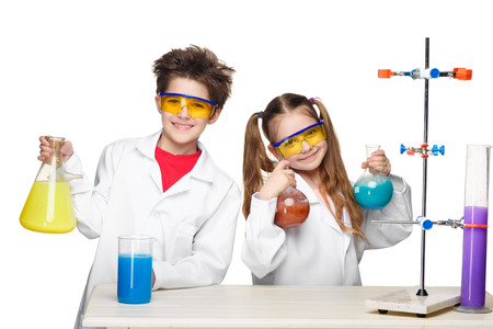 chemistry lesson: Two cute children at chemistry lesson making experiments isolated on white background