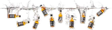 screw jack: Dnepropetrovsk, Ukraine - January 06, 2015: Bottles of whiskey Jack Daniels falling into water. studio shooting