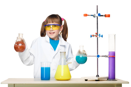tubes: Little girl in a white coat as chemist doing experiment with multicolored chemical fluid in the laboratory isolated on white background Stock Photo