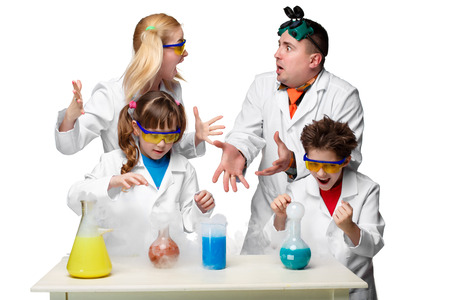 chemistry lesson: Teens and teachesr of chemistry at chemistry lesson making experiments isolated on white background