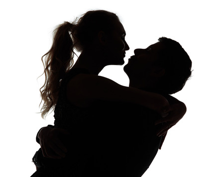 Romantic couple kissing - silhouettes on white background