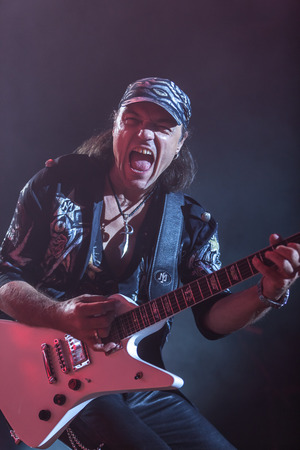 sc: DNIPROPETROVSK, UKRAINE - OCTOBER 31: Matthias Jabs from Scorpions rock band performs live at Sports Palace SC Meteor.  Final tour concert on October 31, 2012 in DNIPROPETROVSK, UKRAINE Editorial