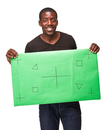 black suit: The smiling african man as black businessman with green panel, isolated on white background. Positive human emotions and advertising of something