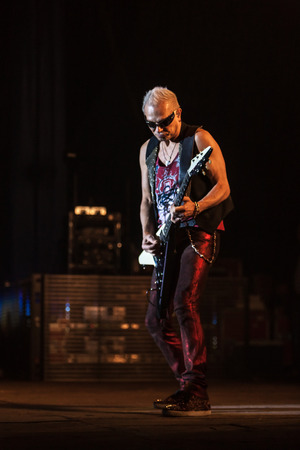 sc: DNIPROPETROVSK, UKRAINE - OCTOBER 31: Rudolf Schenker from Scorpions rock band performs live at Sports Palace SC Meteor.  Final tour concert on October 31, 2012 in DNIPROPETROVSK, UKRAINE