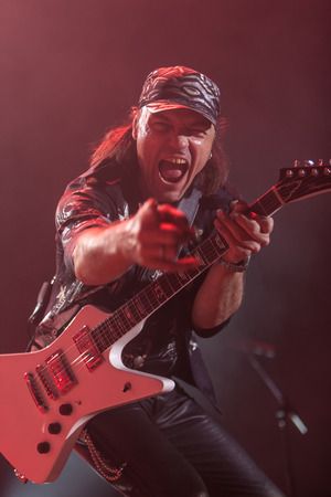 october 31: DNIPROPETROVSK, UKRAINE - OCTOBER 31: Matthias Jabs from Scorpions rock band performs live at Sports Palace SC Meteor.  Final tour concert on October 31, 2012 in DNIPROPETROVSK, UKRAINE Editorial