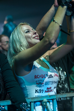 sc: DNIPROPETROVSK, UKRAINE - OCTOBER 31: Young girl - a fan of Scorpions rock band.  live concert at Sports Palace SC Meteor. Final tourconcert on October 31, 2012 in DNIPROPETROVSK, UKRAINE Editorial