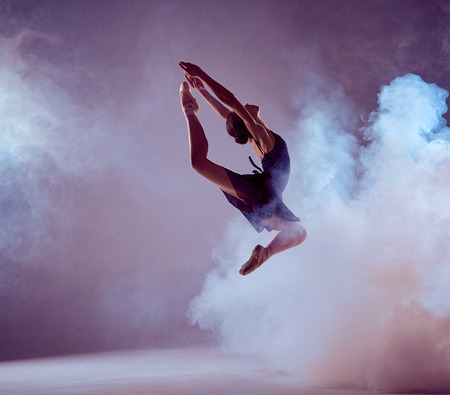 dances: young ballet dancer jumping on a lilac background