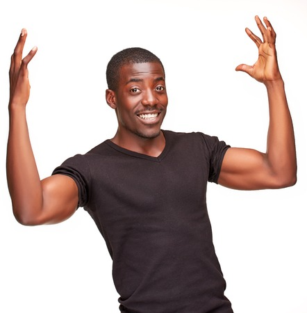portrait of handsome young black african smiling man, isolated on white background Фото со стока