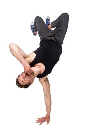 male dancer: Break dancer doing an one handed handstand against a white background
