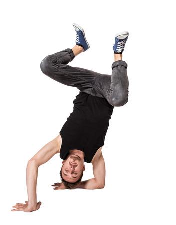 niño saltando: Bailarín de la rotura haciendo una parada de manos una mano sobre un fondo blanco Foto de archivo