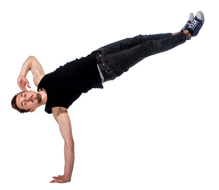 handed: Break dancer doing an one handed handstand against a white background