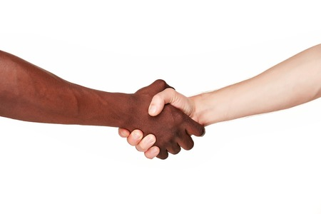 african american handshake: Black and white human hands in a modern handshake to show each other friendship and respect - Arm wrestling against racism. isolated on white background