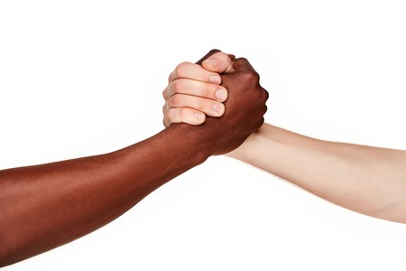 african business man: Black and white human hands in a modern handshake to show each other friendship and respect - Arm wrestling against racism. isolated on white background
