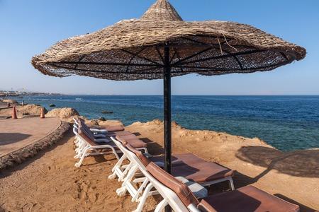 sharm: The beach at the luxury hotel, Sharm el Sheikh, Egypt. umbrella against the blue sky Stock Photo