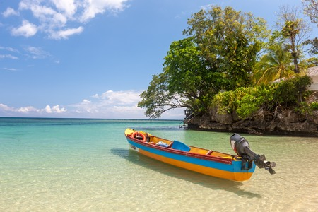 rico: Fish boat on the paradise beach of Jamaica